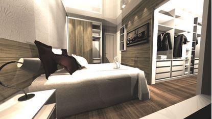 Dormitório casal com painel da cama, armários e porta de correr para dividir ambiente do quarto com closet